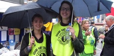Helpful Students Escort Youngsters at Street Fair